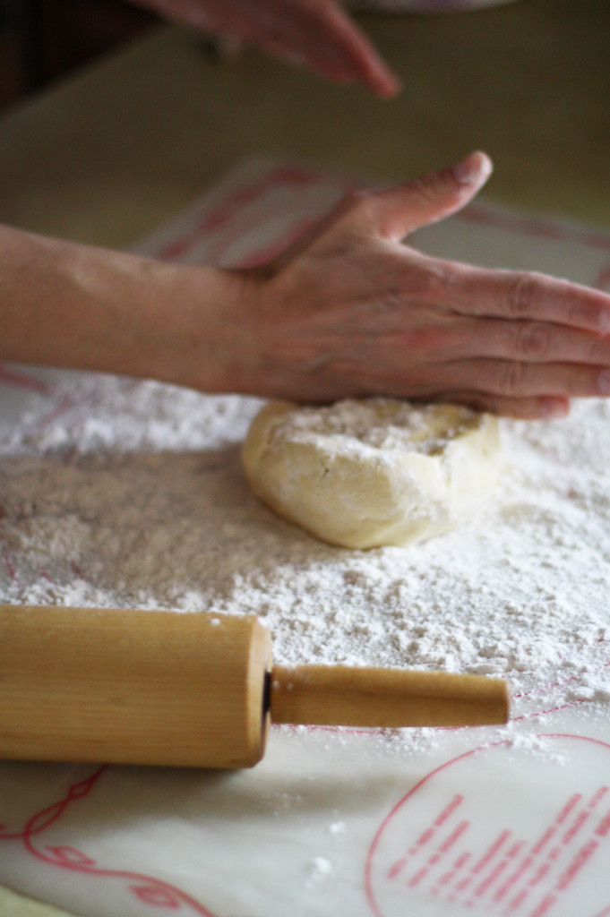 putting dough on surface to roll out